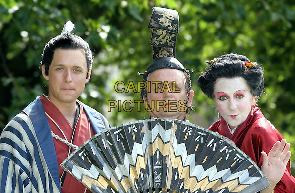"JONATHAN ANSELL, SYLVESTER McCOY, NICHOLA McAULIFFE .The stars promote Gilbert and Sullivan's ""The Mikado"" at the press launch and photocall, Richmond Theatre, Richmond upon Thames, Surrey, England, .August 7th 2008..portrait headshot make-up hat wig japanese fan cast G4 wig opera costumes.CAP/DS.©Dudley Smith/Capital Pictures"