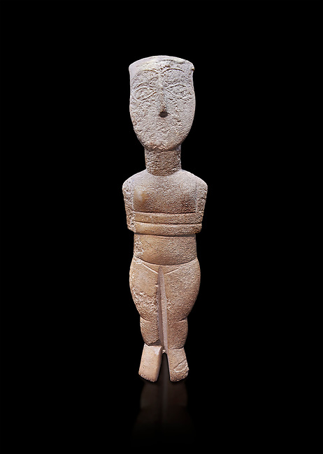 Female figurine statuette : Cycladic Canonical type, Spedos variety. Early Cycladic Period II, (2800-2300 BC), ' Museum of Cycladic Art Athens.  Against black<br /> <br /> <br /> The cycaldic figurine has its facial features preserved in relief. The eyes, eye brows and hair was probably painted which subsequently protected theses areas of the marble from erosion. Red pigment was found on the cheek and thighs. This is a mature work of the Spedos variety