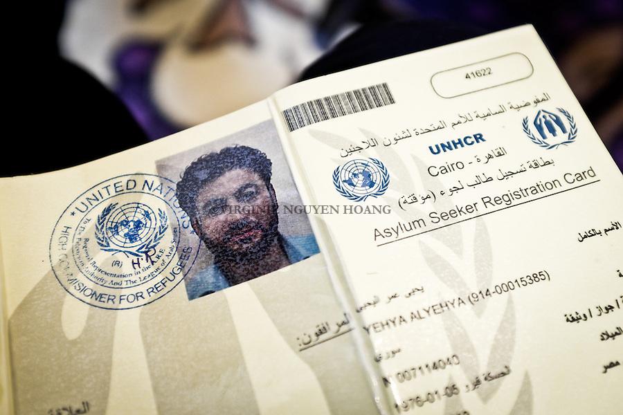 EGYPT, 6 of october city: the yellow card that is given by the UNHCR for asylum seekers in Egypt. This give them the right to have health care in Egypt but not the residency. The 13th february 2014. <br /> <br /> EGYPTE, ville du 6 octobre: la carte jaune qui est donn&eacute;e par l'UNHCR pour les r&eacute;fugi&eacute;s en Egypte donne le droit de recevoir aux soins de sant&eacute; en Egypte mais pas la r&eacute;sidence. 13 f&eacute;vrier 2014.