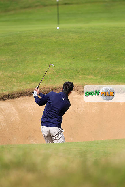 Gary McGrane (The Royal Dublin) in a bunker on the 13th during the South of Ireland Amateur Open Championship Third Round at Lahinch Golf Club  29th July 2013 <br /> Picture:  Thos Caffrey / www.golffile.ie