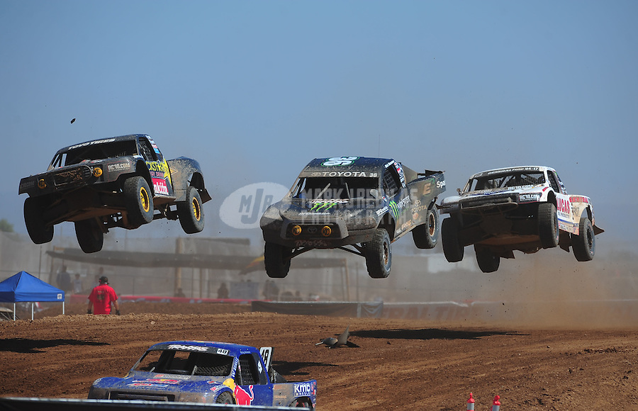 Apr 16, 2011; Surprise, AZ USA; LOORRS driver Kyle Leduc (99) leads Rick Huseman (36) and Carl Renezeder (17) during round 3 at Speedworld Off Road Park. Mandatory Credit: Mark J. Rebilas-.