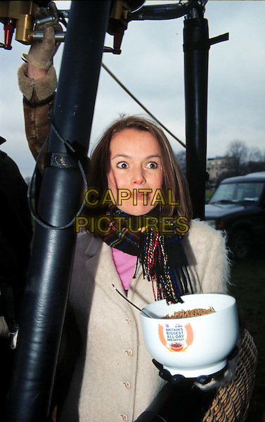 AMANDA HOLDEN .In Hot Air Ballon Eating Breakfast Cereal.funny face, half length, half-elngth.*RAW SCAN - photo will be adjusted for publication*.www.capitalpictures.com.sales@capitalpictures.com.© Capital Pictures