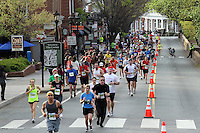 Runners run past the historical Corner area during the Charlottesville 10 miler running race in Charlottesville, Va.  Photo/Andrew Shurtleff