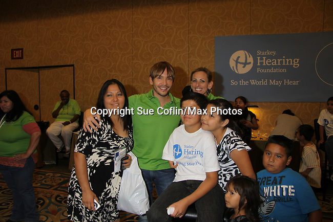 Kevin P of Oprah with kids at the Starkey Hearing Foundation event on June 18, 2011 at the Las Vegas Hilton, Las Vegas, Nevada. (Photo by Sue Coflin/Max Photos)