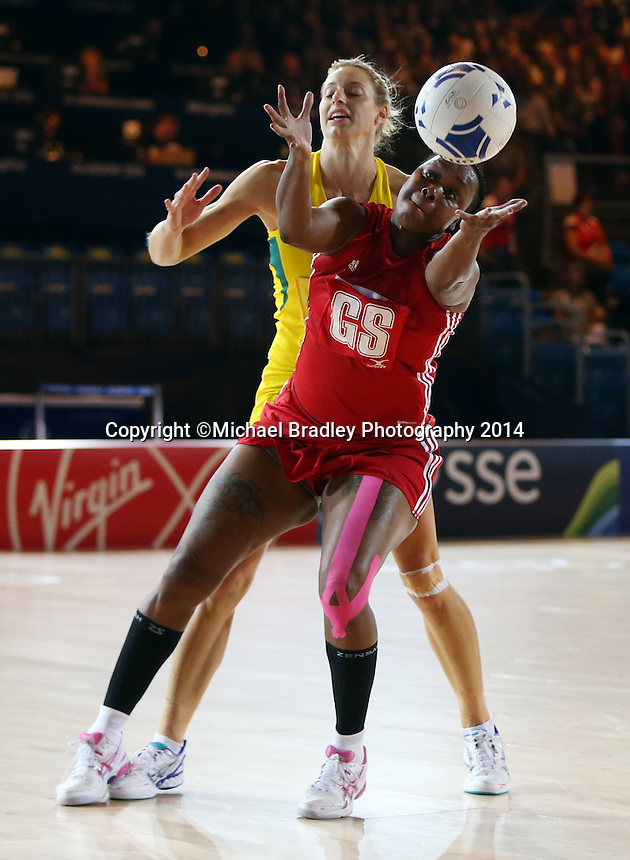28.07.2014 Trinidad and Tobago's Anastacia Wilson and Australia's Laura Geitz in action during the Australia v Trinidad and Tobago netball match at the Commonwealth Games Glasgow Scotland on the 28th of July 2014. Mandatory Photo Credit ©Michael Bradley.