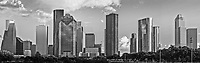 This is a black and white pano of the Houston skyline with all the many skyscraper towering above the city.  Houston is the fourth largest city in the US and has a very impressive skyline of modern high rise skyscrapers. This is a panorama of the Houston skyline that we took from a city park near the bayou close to downtown.  This Photo captures some of Houston architecture tallest skyscrapers like the Chase Tower, Heritage Plaza, the America bank,  the Smith St. buildings, along with the Well Fargo and many other high rises icons of the city.