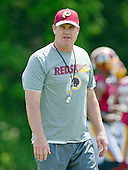 Washington Redskins head coach Jay Gruden watches his team participate in an organized team activity (OTA) at Redskins Park in Ashburn, Virginia on Wednesday, May 25, 2015.<br /> Credit: Ron Sachs / CNP