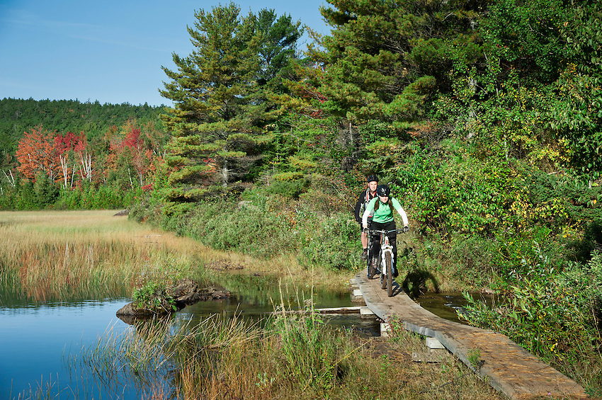 Mountain bikers ride along Lake Manganese outside Copper Harbor Michigan Michigan's Upper Peninsula.