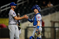 Tennessee Smokies catcher Ian Rice (5) celebrates with relief pitcher Jake Stinnett (43) after the final out of a game against the Birmingham Barons on August 16, 2018 at Regions FIeld in Birmingham, Alabama.  Tennessee defeated Birmingham 11-1.  (Mike Janes/Four Seam Images)