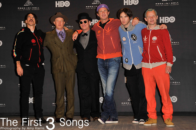 Red Hot Chili Peppers, Flea, Anthony Kiedis, Chad Smith, Josh Klinghoffer, Jogn Frusciante, Jack Irons, and Cliff Martinez in the press room of the Rock & Roll Hall of Fame Induction Ceremony in Cleveland, Ohio on April 14, 2012.