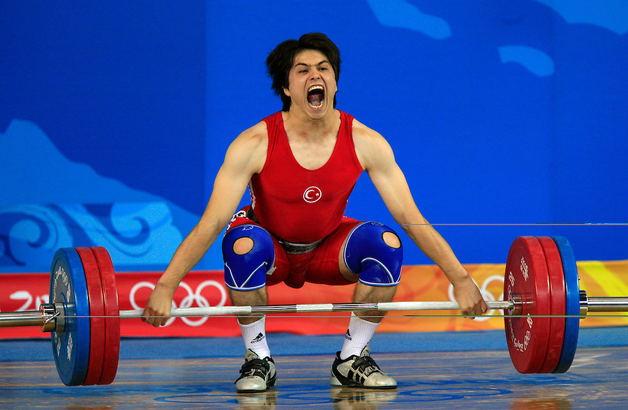 Taner Sagir of Turkey, strains to make a lift as he competes in the men's 77-kilogram weightlifting final during day five of the 2008 Beijing    Olympics in Beijing, China, on Wednesday, Aug. 13, 2008.