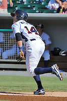 Tennessee Smokies shortstop Logan Watkins #14 runs to first during a game against the Tennessee Smokies at Smokies Park on August 12, 2012 in Kodak, Tennessee. The Smokies defeated the Stars 4-0. (Tony Farlow/Four Seam Images).