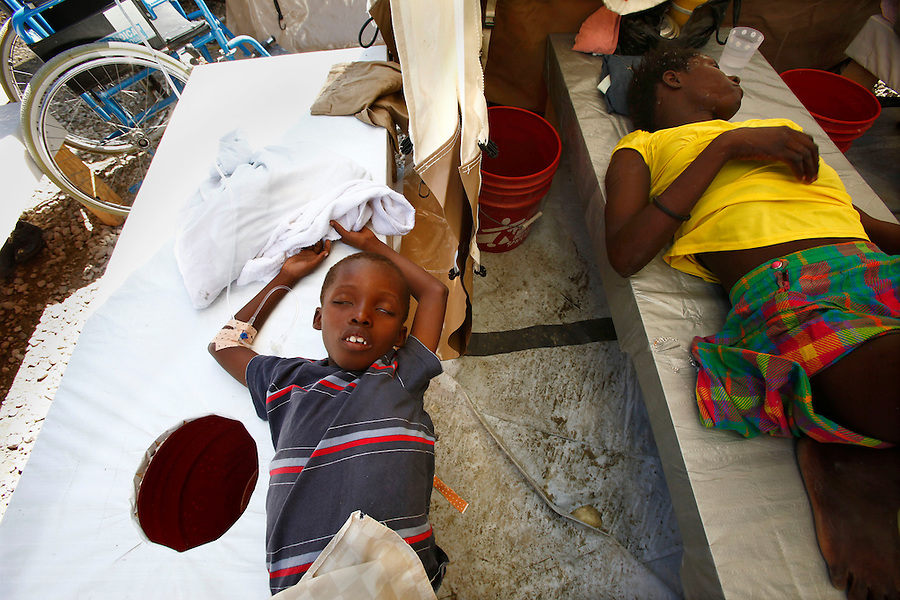 Nov 10, 2010 - Port-au-Prince, Haiti.Patients suffering from cholera-like symptoms get medical treatment in a small, crowded medical clinic set up in tents in the Cite Soleil area of Port-au-Prince, Haiti, Wednesday, November 10, 2010 as fears of a cholera outbreak spread through the area just two days after cases of the infection were confirmed in the area, the poorest slum in Haiti's capital. Officials from the Pan American Health Organization warn that Haiti's cholera epidemic, spread primarily through consuming infected water and food, is likely to grow much larger in the wake of Hurricane Tomas.  (Credit Image: Brian Blanco/ZUMA Press) 1