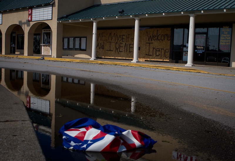 An American flag lies in a puddle of standing water at Atlantic Station Shopping Center in Atlantic Beah, N.C. Early projections of the storm predicted the area would be in the direct course for Hurricane Irene, but the area was largely unharmed. Residents may remain without power until crews are able to repair connections, and some homes sustained wind and water damages.