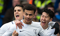 Dele Alli of Spurs celebrates his first goal with Son Heung-Min & Erik Lamela during the Premier League match between Chelsea and Tottenham Hotspur at Stamford Bridge, London, England on 1 April 2018. Photo by Andy Rowland.