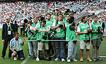 14 June 2006: A group of photographers wait for the teams to come out for the start of the game. Tunisia and Saudi Arabia tied 2-2 at the Allianz Arena in Munich, Germany in match 16, a Group H first round game, of the 2006 FIFA World Cup.