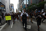A police officer seemed to lead demonstrations in support of a Citizens Police Accountability Council to provide civilian oversight of the Chicago Police Department on Ohio Street at one point in Chicago, Illinois on July 11, 2016.  The demonstration attracted a larger crowd on the heels of last week's racially charged police shootings captured on video of Alton Sterling in Baton Rouge, Louisiana and Philando Castile in the St. Paul suburb of Falcon Heights, Minnesota which was followed by a mass shooting of five police officers by Afghan War veteran Micah Johnson who supported radical and violent black nationalist ideology.