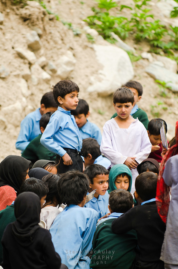 School children gather for lunch, Naranag, Kashmir, India.