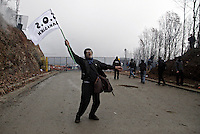 Skouries, Greece Sunday 23 November 2014<br /> Pictured: A male protester with an SOS Halkidiki flag<br /> Re: Riot police called to break up a protest by local residents against a Canadian-run goldmine in Skouries, in the Chalkidiki area. Eldorado firm has been accused of dumping toxic waste generated during gold processing in northern Greece, into local rivers. Teargas was used by the police to disperse the protesters who retaliated with pyrotechnics.