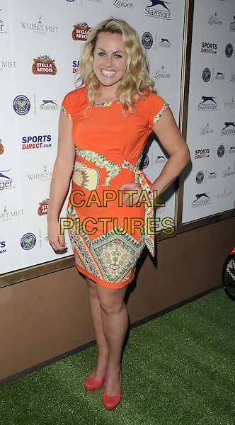 Chimene &quot;Chemmy&quot; Mary Alcott<br /> attended the Slazenger Wimbledon Party, Whisky Mist bar &amp; nightclub, Hertford St., London, England, UK, 27th June 2013.<br /> full length orange dress print shoes coral hand on hip yellow <br /> CAP/CAN<br /> &copy;Can Nguyen/Capital Pictures