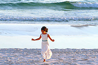 After the wedding, a little girl's thoughts turn to running on the beach at Destin, FL