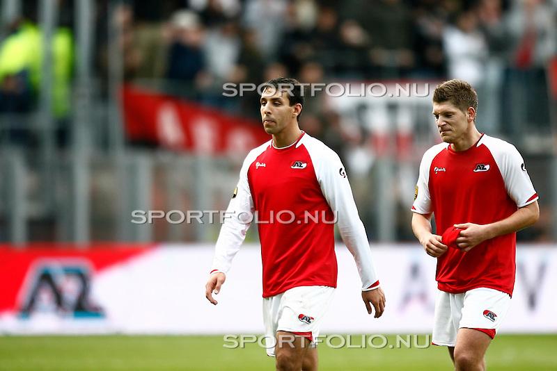 Nederland, Alkmaar, 25 oktober 2009 .Eredivisie.Seizoen 2009/2010.AZ-Ajax (2-4).Mounir El Hamdaoui en aanvoerder Stijn Schaars van AZ balen na de 2-4 nederlaag tegen Ajax