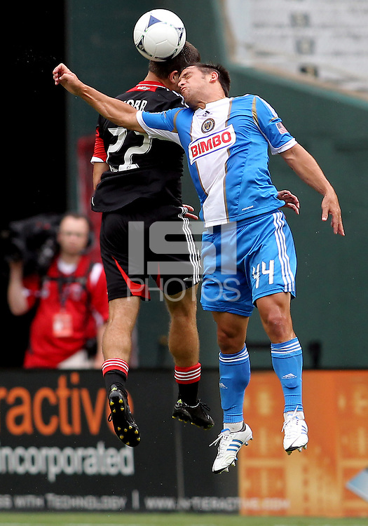 WASHINGTON, D.C. - AUGUST 19, 2012:  Chris Kolb (22) of DC United goes up against former teammate Danny Cruz (44) of the Philadelphia Union during an MLS match at RFK Stadium, in Washington DC, on August 19. The game ended in a 1-1 tie.