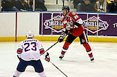 February 22nd 2008:  Matt Carkner (22) of the Binghamton Senators looks to pass during a game vs. the Rochester Amerks at Blue Cross Arena at the War Memorial in Rochester, NY.  The Senators defeated the Amerks 4-0.   Photo copyright Mike Janes Photography