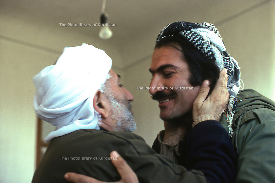 Iran 1979.The mullah of Echnou welcoming Nabi Qadri, peshmerga of KDPI