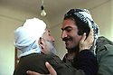 Iran 1979.The mullah of Echnou welcoming Nabi Qadri, peshmerga of KDPI