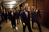 Arlington, VA - May 10, 2007 -- United States President George W. Bush  walks with the Chairman of the Joint Chiefs of Staff, General Peter Pace, and Secretary of Defense Robert Gates to the Chairman's office in the Pentagon on Thursday, May 10, 2007.  <br /> Credit: D. Myles Cullen - DoD via CNP