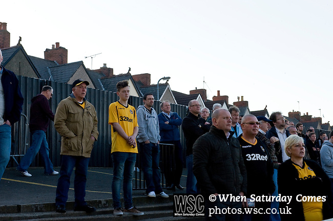 Newport County 1 Exeter City 1, 16/03/2014. Rodney Parade, League Two. Newport County finally return to the Football league after years of turmoil but a poor run of results has dented hopes of reaching the play-offs while Exeter City battle relegation. County supporters on the small section of terracing beside the Hazell Stand. Photo by Simon Gill