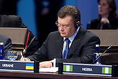 President Viktor Yanukovych of Ukraine attends the opening plenary of the Nuclear Security Summit with U.S. President Barack Obama at the Washington Convention Center in Washington, D.C., U.S., on Tuesday, April 13, 2010. Ukraine's agreement to relinquish its entire stockpile of highly enriched uranium gave Obama the first concrete result for a summit he convened on securing the world's atomic material. .Credit: Andrew Harrer / Pool via CNP