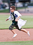 A young Fort Worth Cats fan runs the bases during the American Association of Independant Professional Baseball game between the Grand Prairie AirHogs and the Fort Worth Cats at the historic LaGrave Baseball Field in Fort Worth, Tx. Fort Worth defeats Grand Prairie 8 to 7...