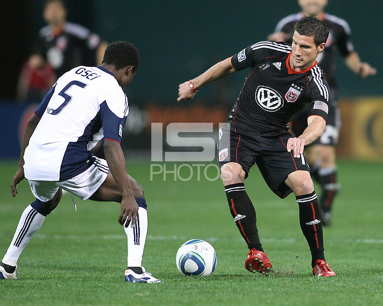 Chris Pontius #13 of D.C. United pushes the ball towards Emmanuel Osei #5 of the New England Revolution during an MLS match on April 3 2010, at RFK Stadium in Washington D.C.