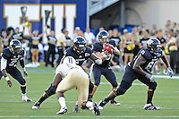 17 September 2011:  FIU quarterback Wesley Carroll (13) takes the snap in the first quarter as the FIU Golden Panthers defeated the University of Central Florida Golden Knights, 17-10, at FIU Stadium in Miami, Florida.