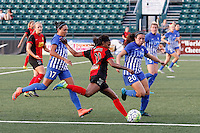 Rochester, NY - Friday May 27, 2016: Western New York Flash forward Taylor Smith (11) is marked by Boston Breakers defender Mollie Pathman (20) and forward Kyah Simon (17). The Western New York Flash defeated the Boston Breakers 4-0 during a regular season National Women's Soccer League (NWSL) match at Rochester Rhinos Stadium.