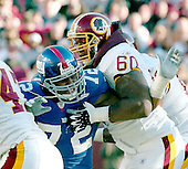Landover, MD - December 24, 2005 -- New York Giant defensive end Osi Umenyiora (72) tries to fight his way through a block by Washington Redskin offensive lineman Chris Samuels (60) in game action at FedEx Field in Landover, MD on December 24, 2005.  The Redskins won the game 35 - 20..Credit: Ron Sachs / CNP.(RESTRICTION: NO New York or New Jersey Newspapers or newspapers within a 75 mile radius of New York City)