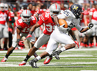 Kent State Golden Flashes wide receiver Ernest Calhoun (25) is pursued by Ohio State Buckeyes safety Chris Worley (35) during Saturday's NCAA Division I football game at Ohio Stadium in Columbus on September 13, 2014. Ohio State won the game 66-0. (Dispatch Photo by Barbara J. Perenic)