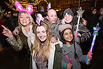 © Joel Goodman - 07973 332324 . 31/12/2013 . Manchester , UK . L-R Wendy Barrington (39) , Kelsey Peers (12, friend of the family) , Bobby Kendall (41) (Elaine's husband) , Olivier Barrington (seven) (Wendy's daughter) and Elaine Kendall (42) (Wendy's sister) (all from Radcliffe, all correct) . Revellers gather in Piccadilly Gardens ahead of the New Years fireworks display to usher in 2014 . Photo credit : Joel Goodman