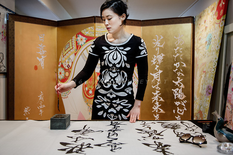 Tokyo, February 27 2012 - Japanese calligrapher Sisyu writing at her atelier.