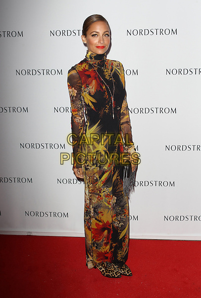 Nicole Richie<br /> Nicole Richie hosts grand opening of Nordstrom at The Americana at brand to benefit Ascencia And Hillsides held at Nordstrom at The Americana at Brand, Glendale, California, USA.<br /> September 17th, 2013<br /> full length yellow black red pattern print dress leopard print shoes high collar long sleeves clutch bag<br /> CAP/ADM/KB<br /> &copy;Kevan Brooks/AdMedia/Capital Pictures
