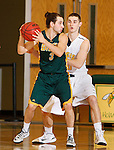 JANUARY 30, 2015 -- Brady Bisgaard #3 of Black Hills State holds the ball away from Bryan Siefker #30 of Regis University during their Rocky Mountain Athletic Conference men's basketball game Friday evening at the Donald E. Young Center in Spearfish, S.D.  (Photo by Dick Carlson/Inertia)