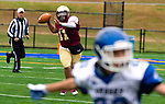 WATERBURY,  CT-101219JS13-  Sacred Heart-Kaynor's Alex Gonzalez (11) gets a pass off  during their game against Crosby Saturday at Municipal Stadium in Waterbury.<br /> Jim Shannon Republican-American