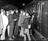 BNPS.co.uk (01202 558833)<br /> Pic: AndrewWright/BNPS<br /> <br /> Passengers boarding the last train in 1972.<br /> <br /> A plucky seaside railway that refused to die is finally rejoing the rail network today after a 45 year fight to reverse the Beeching axe.<br /> <br /> At 10.23 sharp a train will once again leave Swanage in Dorset to rejoin the main network at Wareham, thanks to an army of volunteers who have spent 45 years painstakingly rebuilding their line. 
