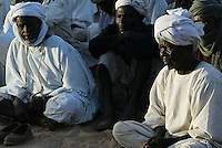 Men gather to listen to an SLA ( sudan liberation army ) meeting in Birmaza in north darfur on Nov 2004. the genocide began two years ago, since then hundreds of thousands of innocent darfurians were killed and millions have been displaced. athough 200.000 floded into Chad and found help from the international community, the majority still lives in fear in the inner borders in drammatic conditions.