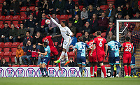Goalkeeper Jamal Blackman of Wycombe Wanderers tries to punch clear under pressure from Teddy Mezague of Leyton Orient during the Sky Bet League 2 match between Leyton Orient and Wycombe Wanderers at the Matchroom Stadium, London, England on 1 April 2017. Photo by Andy Rowland.