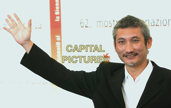 "TSUI HARK.Photocall of the film ""Seven Swords"",.62nd International Film Festival,.Venice, 31st August 2005.portrait headshot movie black jacket white shirt grey gray goatie beard mustache hand arm.www.capitalpictures.com.sales@capitalpictures.com.© Capital Pictures."
