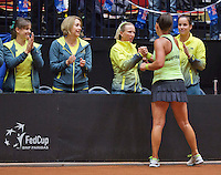 April 18, 2015, Netherlands, Den Bosch, Maaspoort, Fedcup Netherlands-Australia,   Casey Dellacqua (AUS) is congretulated by her team members<br /> Photo: Tennisimages/Henk Koster