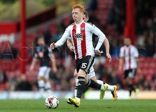 April 14th 2017,  Brent, London, England; Skybet Championship football, Brentford versus Derby County; Ryan Woods of Brentford brings the ball forward